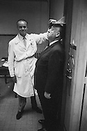 Alfred Hitchcock being measured in the jail of the Conciergerie in Paris, the only time a photographer was allowed in this part of the building.<br />