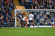 Portsmouth defender Christian Burgess (6) scores a goal to make it 1-1 during the EFL Sky Bet League 2 match between Portsmouth and Wycombe Wanderers at Fratton Park, Portsmouth, England on 10 September 2016. Photo by David Charbit.