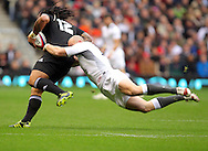 © SPORTZPICS / Seconds Left Images 2010 - England's Mike Tindall dives to try and stop New Zealand's Ma'a Nonu attacking at pace -  England v New Zealand All Blacks - Investec Challenge Series - 06/11/2010 - Twickenham Stadium  - London - All rights reserved..