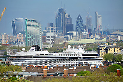 &copy; Licensed to London News Pictures.04/05/2018<br /> GREENWICH, UK.<br /> Photo credit:Grant Falvey/LNP<br /> Crusie ship docked in Greenwich.<br /> A sunny start to the May bank holiday weekend  at Greenwich Park, Greenwich.
