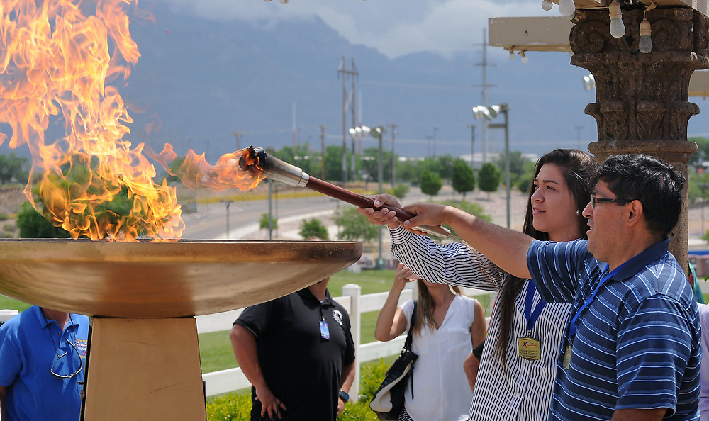 jt050917e/sports/jim thompson/  Tyler Hernandez and Dominic Maestas are the 2016 male and female athletes of the year light the ceremonial torch for the start of the 2017 New Mexico Games.  Tuesday May. 09, 2017. (Jim Thompson/Albuquerque Journal)