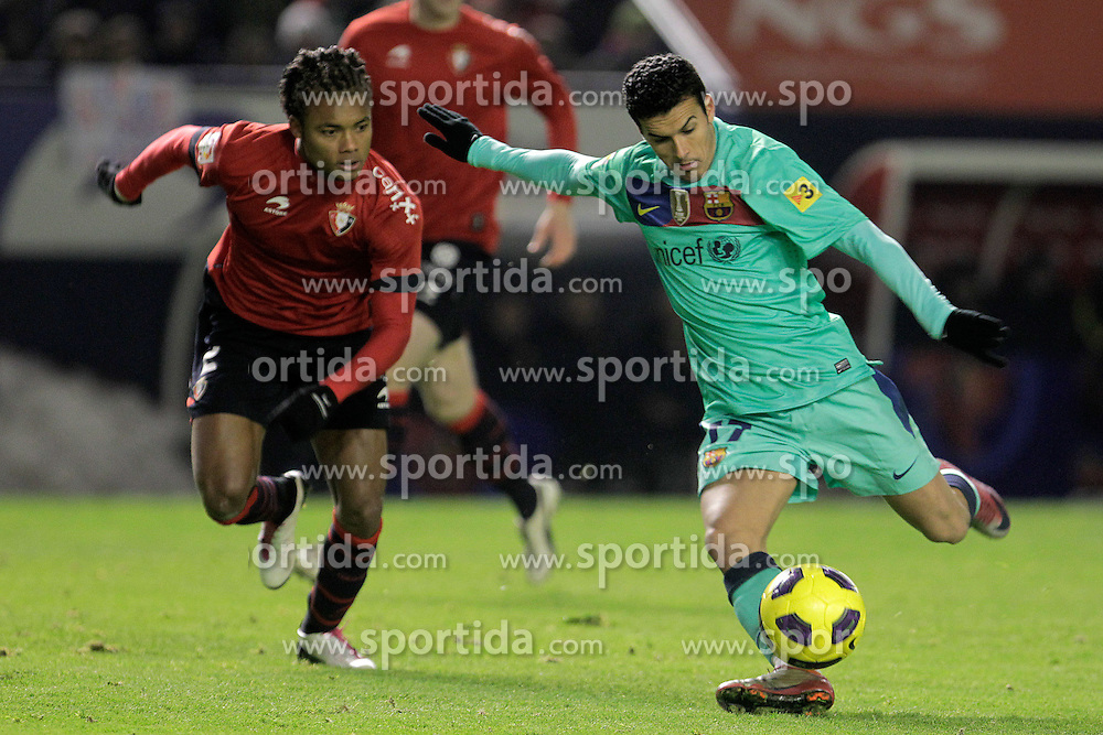 04.12.2010, Estadio Reyno de Navarra, Pamplona, ESP, Primera Division, Real Madrid vs FC Valencia, im Bild Osasuna's Nelson Augusto Tomar (l) and FC Barcelona's Pedro Rodriguez during La Liga match.December 04,2010. . EXPA Pictures © 2010, PhotoCredit: EXPA/ Alterphotos/ Acero +++++ ATTENTION - OUT OF SPAIN / ESP +++++
