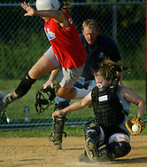 Times Herald-Record/TOM BUSHEY.Otisville's Michele Cauchard leaps to avoid a tag by Warwick catcher Dani Finn during the District 19  Senior girls championship game yesterday in the Town of Wallkill..July 14, 2003.