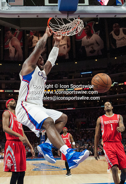 Feb. 11, 2015 - Los Angeles, CA, USA - Los Angeles Clippers' Glen Davis slams one down as Houston Rockets' Trevor Ariza looks on during the first half at Staples Center in Los Angeles on Wednesday.