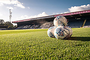 Some footballs lay on the pitch in the Crown Oil Arena before the EFL Sky Bet League 1 match between Rochdale and Lincoln City at the Crown Oil Arena, Rochdale, England on 17 September 2019.