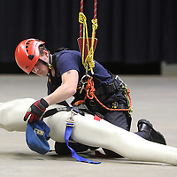 Adam Robison | BUY AT PHOTOS.DJOURNAL.COM<br /> Chris Whiteside, driver at the New Albany Fire Department, places a harness onto a rescue dummy as he trains on the high line traverse during the Mississippi Task Force 1 Training at the Bancorpsouth Arena Thursday in Tupelo. The high line traverse training is used to simulate an emergency rescue used for someone stuck in a ravine.
