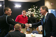 NYSERDA President & CEO John Rhodes shakes hands with graduates after the graduation ceremony for Solar Ready Veterans at Fort Drum on Wednesday, February 17, 2016.