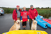 Chairman of the Galway branch of the Irish Guide Dogs for the blind Frank Downes and Gallagher  with Agnes O Donnell Killimor, and John Gannon with Feather who took part in the 26th amphicat row in aid of  The Irish Guide Dogs for the Blind, on the Corrib <br /> . Photo: xposure
