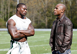 "October 8, 2009; Florham Park, NJ; USA; Floyd ""Money"" Mayweather (r) chats with New York Jets RB Thomas Jones after practice in Florham Park, NJ."