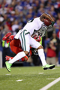 New York Jets wide receiver Brandon Marshall (15) gets tackled by Buffalo Bills cornerback Stephon Gilmore (24) as he catches a pass plus a face mask penalty for a gain of 18 yards and a first down to the Buffalo Bills 4 yard line in the second quarter during the 2016 NFL week 2 regular season football game against the against the Buffalo Bills on Thursday, Sept. 15, 2016 in Orchard Park, N.Y. The Jets won the game 37-31. (©Paul Anthony Spinelli)