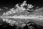 Clouds reflected in Muncho Lake and the Northern Canadian Rocky Mountains<br />