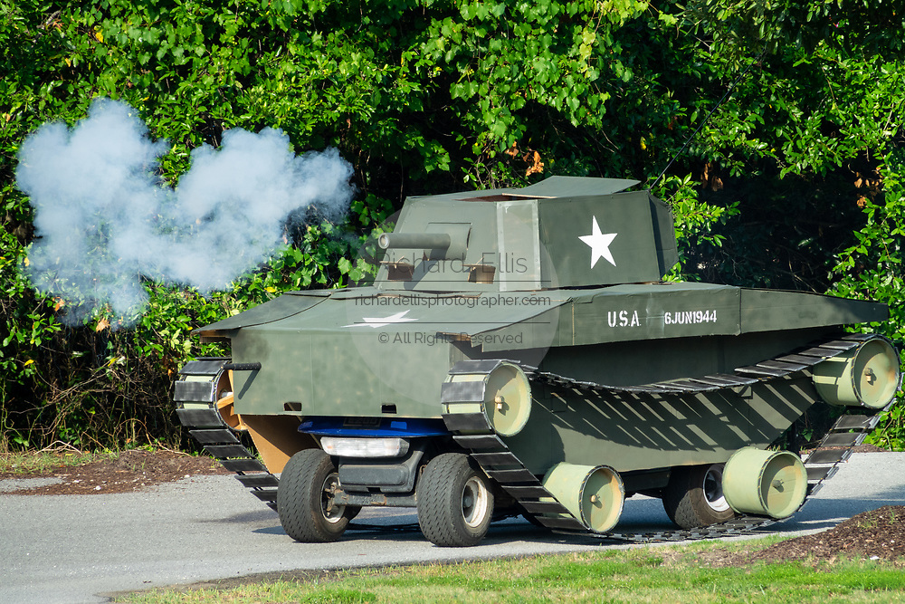 A golf cart decorated as a military tank fires blanks from the cannon during the annual Independence Day parade July 4, 2019 in Sullivan's Island, South Carolina. The tank was a tongue-in-check reference to the controversy over the military parade in Washington.