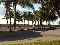 Woman working out in the morning in Miami Beach in front of Ocean Drive Street. South Beach is a tourist attraction in Miami.