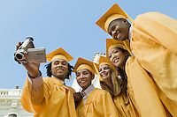 Graduates Looking at Video Camera