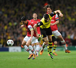 Arsenal's Mikel Arteta tackles Borrusia Dortmund's Robert Lewandowski - Photo mandatory by-line: Alex James/JMP - Tel: Mobile: 07966 386802 22/10/2013 - SPORT - FOOTBALL - Emirates Stadium - London - Arsenal v Borussia Dortmund - CHAMPIONS LEAGUE - GROUP F