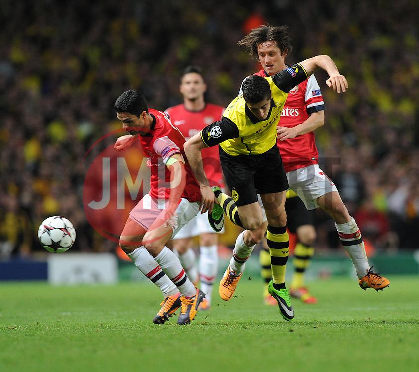 Arsenal's Mikel Arteta tackles Borrusia Dortmund's Robert Lewandowski - Photo mandatory by-line: Alex James/JMP - Tel: Mobile: 07966 386802 22/10/2013 - SPORT - FOOTBALL - Emirates Stadium - London - Arsenal v Borussia Dortmund - CHAMPIONS LEAGUE - GROUP F