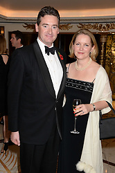 COL.DAN HUGHES and his wife JESSICA at Fashion For The Brave at The Dorchester, Park Lane, London on 8th November 2013.