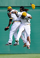 PITTSBURGH, PA - SEPTEMBER 15:  Marlon Byrd #2 of the Pittsburgh Pirates celebrates with Starling Marte #6 and Andrew McCutchen after the game against the Chicago Cubs on September 15, 2013 at PNC Park in Pittsburgh, Pennsylvania.  (Photo by Joe Sargent/Getty Images) *** Local Caption ***