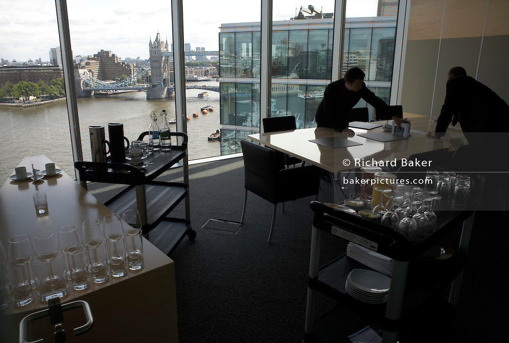 Top floor restaurant prepared for executive lunch meetings in an auditing company's London headquarters