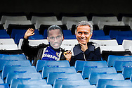 Two young fans wearing Didier Drogba of Chelsea and Jose Mourinho Manager of Chelsea masks before the Barclays Premier League match at Stamford Bridge, London<br /> Picture by David Horn/Focus Images Ltd +44 7545 970036<br /> 13/09/2014