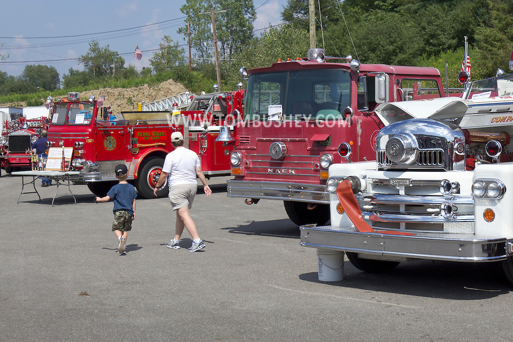 Circleville, New York - People look at antique fire trucks on display at the Catskill Fire Cats 36th Annual Muster on Aug. 4, 2012.