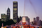 Buckingham Fountain and city skyline at dusk, Chicago, Illinois