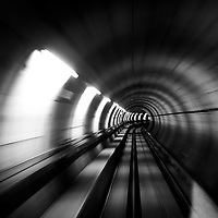 Motion in a train traveling through the underground of a city.