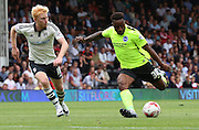 Kazenga LuaLua getting past Ben Pringle and shooting during the Sky Bet Championship match between Fulham and Brighton and Hove Albion at Craven Cottage, London, England on 15 August 2015. Photo by Matthew Redman.