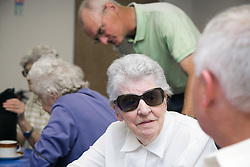 People sitting and talking at the Nottingham Royal Society for the Blind (NRSB),