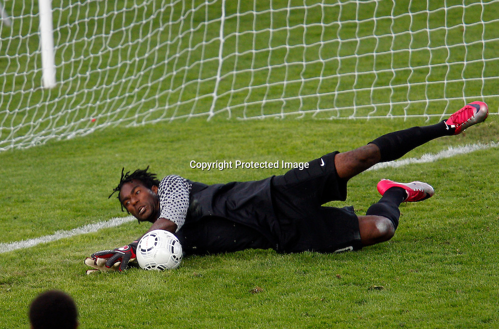 PNG's Ronald Warisan saves a shot. OFC Men's Olympic Qualifier New Zealand 2012, New Zealand v Papua New Guinea, Owen Delany Park Taupo, Friday 16th March 2012. Photo: Shane Wenzlick