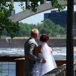 The Bride and Groom are enjoying a beautiful scenic background on the river.