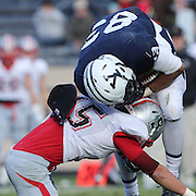 Robert Clemons III, Yale, is tackle by Patrick O'Neill, Brown, during the Yale V Brown, Ivy League Football match at Yale Bowl. Yale won the match 24-17. New Haven, Connecticut, USA. 9th November 2013. Photo Tim Clayton