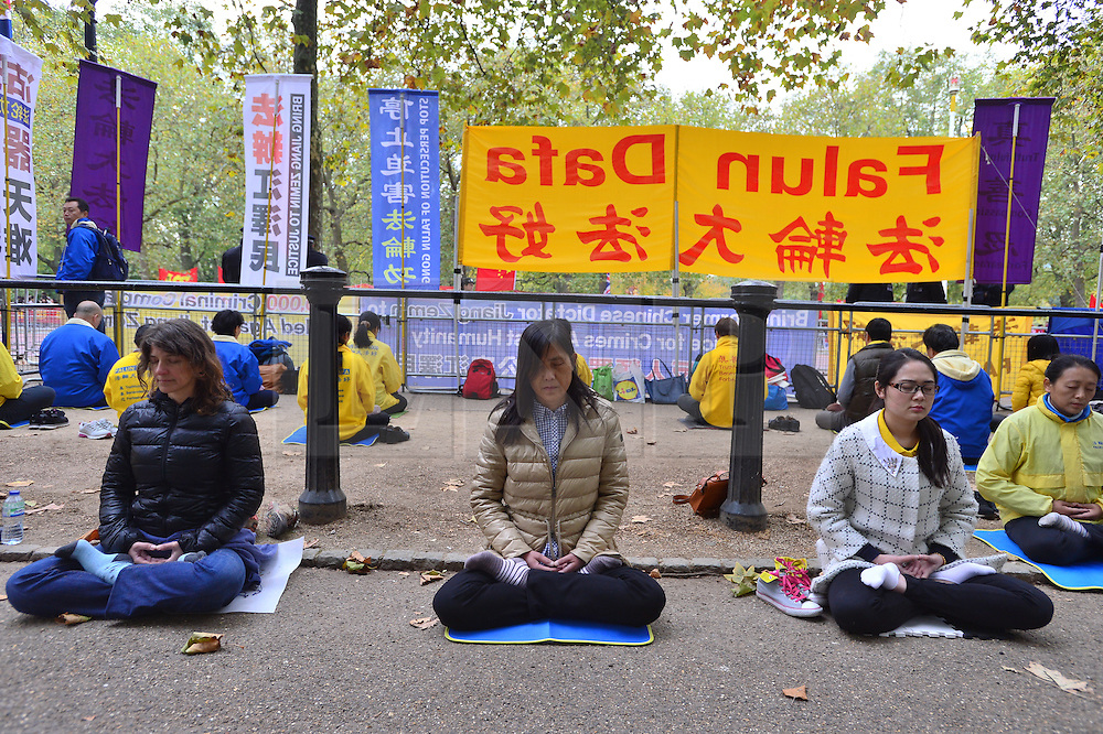 © Licensed to London News Pictures. 20/10/2015. London UK. Protestors gather on the Mall in London leading to Buckingham palace as Chinese President Xi Jinping starts day one of a four day State Visit to the United Kingdom. Photo credit: Ben Cawthra/LNP