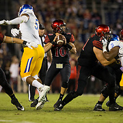 21 October 2016: The San Diego State Aztecs football team takes on the San Jose State Spartans Friday night at Qualcomm Stadium. San Diego State quarterback Christian Chapman (10) drops back to pass in the first quarter. The Aztecs lead the Spartans 21-3 at halftime. www.sdsuaztecphotos.com