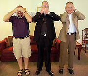 "Archbishop Dolan plays the part of ""speak no evil"" (Sam Lucero photo)"