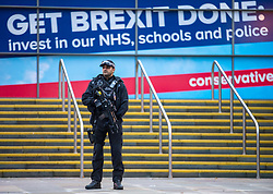 © Licensed to London News Pictures. 30/09/2019. Manchester, UK. Armed police patrol the conference centre on the second day of the Conservative Party Conference at Manchester Central in Manchester. Photo credit: Andrew McCaren/LNP