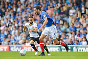 Portsmouth Defender, Christian Burgess (6) betas Walsall Midfielder, Erhun Oztumer (10) to the ball during the EFL Sky Bet League 1 match between Portsmouth and Walsall at Fratton Park, Portsmouth, England on 19 August 2017. Photo by Adam Rivers.