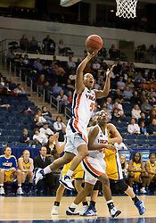 Virginia guard Sharnee Zoll (5) leaps for a layup against UCSB.  The #4 seed/#24 ranked Virginia Cavaliers defeated the #13 seed Santa Barbara Gauchos 86-52 in the first round of the 2008 NCAA Division 1 Women's Basketball Championship at the Ted Constant Convocation Center in Norfolk, VA on March 23, 2008