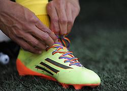 Norwich's Josh Murphy ties up  his rainbow colour boot - Photo mandatory by-line: Alex James/JMP - Mobile: 07966 386802 30/08/2014 - SPORT - FOOTBALL - Cardiff - Cardiff City stadium - Cardiff City  v Norwich City - Barclays Premier League