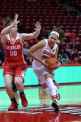 01 January 2017: Katrina Beck heads for the lane and draws attention from Danielle Brewer during an NCAA Missouri Valley Conference Women's Basketball game between Illinois State University Redbirds the Braves of Bradley at Redbird Arena in Normal Illinois.