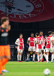 Quincy Promes #11 of Ajax and Nicolas Tagliafico #31 of Ajax, Sergino Dest #28 of Ajaxcelebrate the first goal for Ajax during the match between Ajax and PSV at Johan Cruyff Arena on February 02, 2020 in Amsterdam, Netherlands