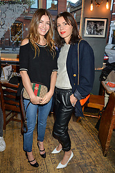 Left to right, SARA MACDONALD and LARA BOHINC at a quiz night hosted by Zoe Jordan to celebrate the launch of her men's ZJKNITLAB collection held at The Larrick Pub, 32 Crawford Place, London on 20th April 2016.
