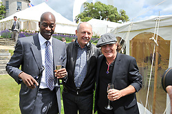 Left to right, EDWIN MOSES, RON DENNIS and singer BRIAN JOHNSON at a luncheon hosted by Cartier for their sponsorship of the Style et Luxe part of the Goodwood Festival of Speed at Goodwood House, West Sussex on 1st July 2012.