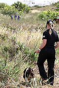 Scotland Yard forensic technician and sniffer dogs search area in Praia da Luz as police continue to look for the  body of Maddie McCann. <br /> ©Exclusivepix