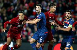 Liverpool's Virgil van Dijk (left), Red Star Belgrade's Milos Degenek (second left), Liverpool's Roberto Firmino (second right) and Red Star Belgrade's Filip Stojkovic in action