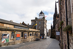 Edinburgh, Scotland, UK. 18 April 2020. Views of empty streets and members of the public outside on another Saturday during the coronavirus lockdown in Edinburgh. Normally busy Royal Mile leading to Edinburgh Castle is deserted. Iain Masterton/Alamy Live News