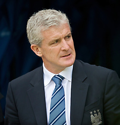 WIGAN, ENGLAND - Sunday, October 18, 2009: Manchester City's manager Mark Hughes before the Premiership match against Wigan Athletic at the JJB Stadium. (Pic by David Rawcliffe/Propaganda)