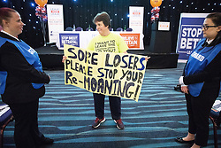 "© Licensed to London News Pictures . 22/09/2018. Bolton, UK. A woman holds up a protest banner reading "" Sore losers please stop your re-moaning "" . Pro Brexit campaign group Leave Means Leave host a "" Save Brexit "" and "" Chuck Chequers "" rally at the University of Bolton Stadium , attended by leave-supporting politicians from a cross section of parties , including Conservative David Davis , former UKIP leader Nigel Farage and Labour's Kate Hoey . Photo credit: Joel Goodman/LNP"