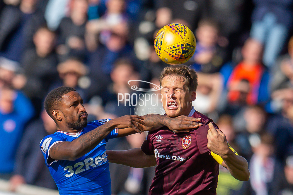 Christophe Berra (#6) of Heart of Midlothian FC wins a header against Jermain Defoe (#9) of Rangers FC during the Ladbrokes Scottish Premiership match between Heart of Midlothian and Rangers FC at Tynecastle Park, Edinburgh, Scotland on 20 October 2019.