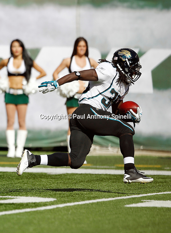 Jacksonville Jaguars running back Deji Karim (35) runs the ball during the NFL week 2 football game against the New York Jets on Sunday, September 18, 2011 in East Rutherford, New Jersey. The Jets won the game 32-3. ©Paul Anthony Spinelli